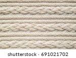 pigtails on beige knitwear...   Shutterstock . vector #691021702