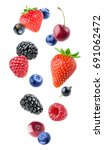 isolated berries. falling... | Shutterstock . vector #691062472