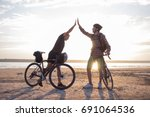 couple bikers gives a high five ... | Shutterstock . vector #691064536