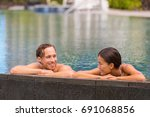 wellness spa pool couple... | Shutterstock . vector #691068856