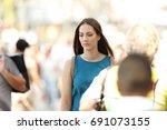 sad woman feeling alone walking ... | Shutterstock . vector #691073155