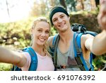 Happy Young Couple In Hiking...
