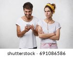 angry young woman holding arms... | Shutterstock . vector #691086586