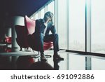 sad businessman is sitting on... | Shutterstock . vector #691092886