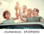 happy young people are clinking ... | Shutterstock . vector #691096042