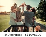 back view of happy young people ... | Shutterstock . vector #691096102