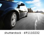 black car driving fast on a... | Shutterstock . vector #691110232