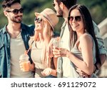 cheerful young people are... | Shutterstock . vector #691129072