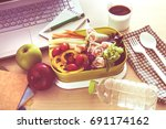 close up green lunch box on... | Shutterstock . vector #691174162