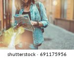 female tourist with a backpack... | Shutterstock . vector #691175956