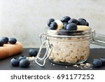 jar of overnight oats with... | Shutterstock . vector #691177252