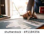 businessman plans working new... | Shutterstock . vector #691184356