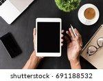 hand showing digital tablet... | Shutterstock . vector #691188532