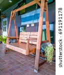 wooden swing seat at outdoor  ... | Shutterstock . vector #691191178