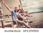 happy friends resting on a yacht   Shutterstock . vector #691194505