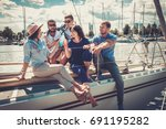 happy friends resting on a yacht | Shutterstock . vector #691195282