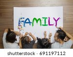 happy family lying paint family ... | Shutterstock . vector #691197112