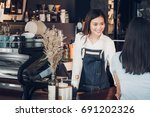 asian woman barista wear jean... | Shutterstock . vector #691202326