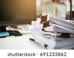 stack of papers documents in... | Shutterstock . vector #691233862