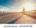 this man is jogging on street... | Shutterstock . vector #691249138