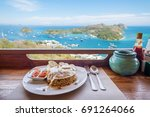 beautiful sea view with bowl of ... | Shutterstock . vector #691264066