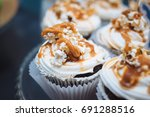 homemade cupcakes with caramel... | Shutterstock . vector #691288516