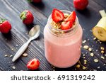 strawberry and banana smoothie... | Shutterstock . vector #691319242