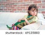 child sitting on a sofa and... | Shutterstock . vector #69135883