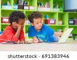 two boy kid lay down on floor... | Shutterstock . vector #691383946
