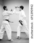 Small photo of Fight between two aikido fighters