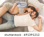 couple in love pregnant lie in... | Shutterstock . vector #691391212