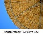 beach umbrella and blue sky | Shutterstock . vector #691395622