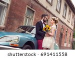 newlywed couple standing in the ... | Shutterstock . vector #691411558