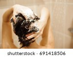 beautiful woman taking a shower.... | Shutterstock . vector #691418506