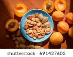 healthy apricot kernel seed on...   Shutterstock . vector #691427602