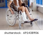 a young girl in a wheelchair is ... | Shutterstock . vector #691438906