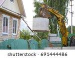 excavator lifts the load  ...   Shutterstock . vector #691444486