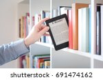 e book reader on a stack of... | Shutterstock . vector #691474162