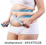 overweight woman measuring her... | Shutterstock . vector #691475128
