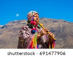 peruvian man playing a flute ... | Shutterstock . vector #691477906