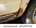 perforating corrosion of old... | Shutterstock . vector #691492102