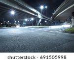 freeway in night with cars... | Shutterstock . vector #691505998