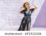 slim girl in denim tank top and ... | Shutterstock . vector #691512106
