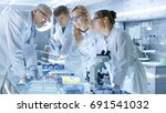 team of medical research... | Shutterstock . vector #691541032
