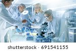 team of medical research... | Shutterstock . vector #691541155