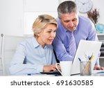 mature man helping his... | Shutterstock . vector #691630585