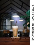 iced coffee on wooden table. | Shutterstock . vector #691641676