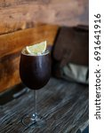 iced coffee on wooden table. | Shutterstock . vector #691641916
