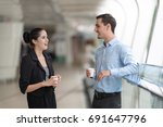 two colleagues walking in... | Shutterstock . vector #691647796