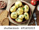 boiled young potatoes with dill ... | Shutterstock . vector #691651015